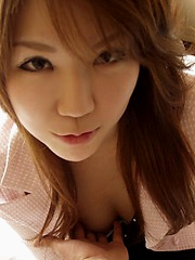 Slutty Mizuki enjoys showing off her perfect tits when she poses for pictures