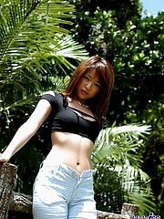 Asian babe Asuka enjoys sunning and playing naked on the beach
