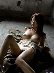 Hot Asian babe is quite a slut and strips off to show her big tits and fine ass