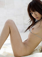 Lovely Asian model enjoys being naked around her house for the freedom