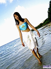 Asian cock tease likes running naked on the beach and playing in the water