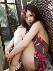Asian beauty is sexy and enjoying showing off her tight ass in a thong