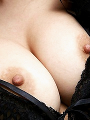 Asian model shows off her big tits and her lovely tight round ass
