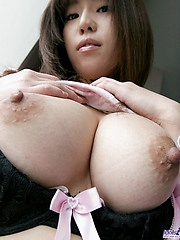 Horny Haduki enjoys showing off her big tits and perfect ass for photos
