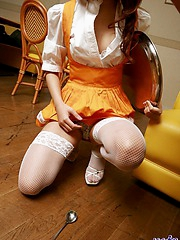Lovely Asian teen in maid uniform and fishnets shows off her tight ass