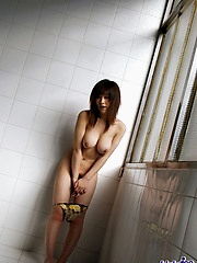 Hot Asian model takes off her clothes and shows her big tits and hot pussy