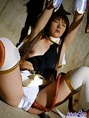 Asian slut is wrapped up and on the floor with a large tentacle goiing for pussy