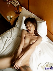 Mariko gets naked and her date is masturbating her pussy with a large toy