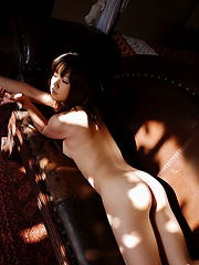 Pretty Japanese doll shows off her nice tits, ass and hairy pussy