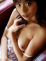 Cute Asian model likes to show peeks at her pussy and tight ass