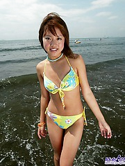 Japanese strumpet is a huge cock tease when she is at the beach