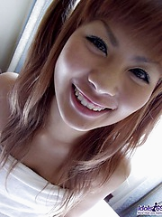 Asian tramp Aki dresses for the clubs after she showers and washes her pussy