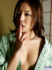 Yui caresses her nice tits and pussy because she enjoys her own wet pussy
