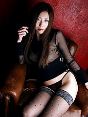 Lovely Asian tramp shows off her great tits and groomed twat with much pleasure