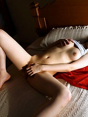 Horny Japanese tramp likes to finger her pussy and show off her hot tits a lot