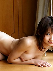 Horny Japanese college girl loves to show off her naked body inthe locker room