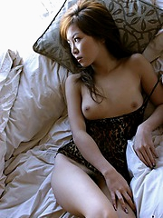 Japanese fuck doll is lovely in her feather boa as she shows her perfect body