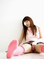 Lovely Japanese teen enjoys showing off her hot body with a smile