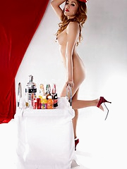 Lulani posing as a sexy topless stewardess