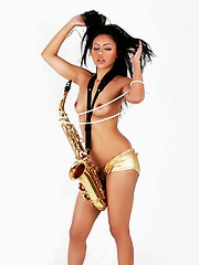 Janice in panties playing the saxophone topless