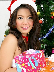 A very pretty Pang unwrapping her Xmas gift to us