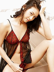 Pocky Kuriko in lingerie shows off her big brown eyes
