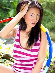 Big breasted Nancy Ho plays with her hula hoop