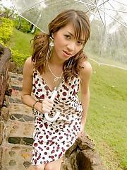 Maya Asawawong peels off her panties in a fern garden