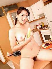 Yoko Takawa giving cooking lessons but gets distracted by her cucumber