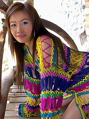 Shows off through her loosely knitted sweater