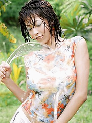 Chan Ching Ming gives her fantastic body an outdoors hosing