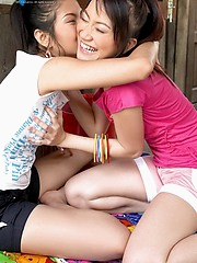 Two asian lesbians at an old country house playing