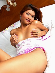 Oil Marin shows off big nipples and tight pussy