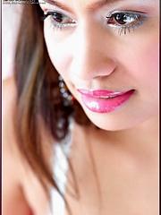 Angelena Loly licks her luscious titties