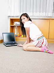 Bored with working on her laptop Beau Arpinya does a strip show for us
