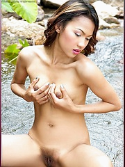 Judy Virada gets naked and wet by the river