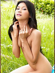 Pink Pampa lays out naked on the grass