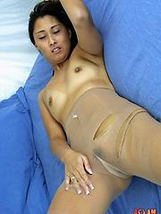 Mikayla-Yamada playfully rips her sheer pantyhose