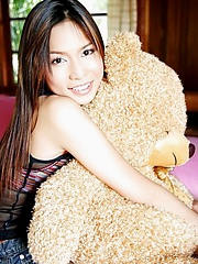 Sweety pie Ballon Barichat lying around with her teddy bear