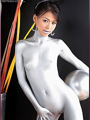 Naomi Chattee covers her body in silver paint