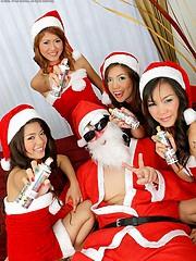 Santa enjoying his four favorite naughty girls