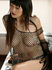 Jenny looks so damn sexy and charming in that fishnet dress
