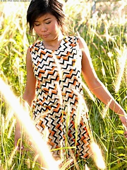Rolling in the hay with her zig-zag dress
