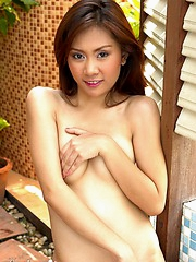 Cute and petite Asian hoe Erin Law strips outdoors