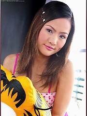 Seductive and cute Asian babe Emily Hook