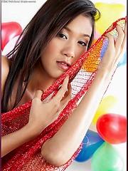 Irene Fah strips in a room full of balloons