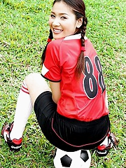 Soccer girl Arisa Sunaree strips out of her uniform on the field
