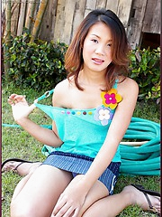 Hiroko Rumi finds good use for outdoor lawn hose