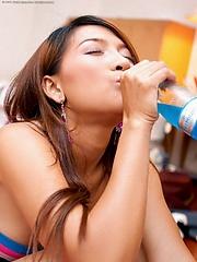 Koko Tongpu slides both sets of lips around a bottle