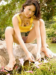 Popular Thai softcore model Amara Bhunawat watering her bush